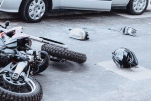 Motorcycle lying on road after accident
