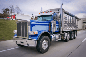 Blue dump truck on the road