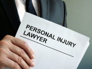 personal injury lawyer holding legal documents