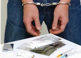 A man is handcuffed for drug possession in New Jersey