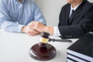 A New Jersey lawyer speaks with a client.