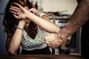 A woman protecting herself from a man in a New Jersey domestic violence act.