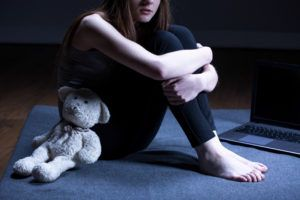 A child was molested and sits alone.
