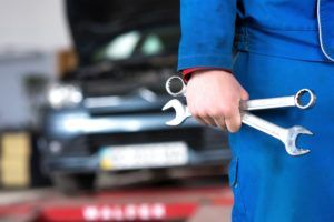 Hand of car mechanic with wrench