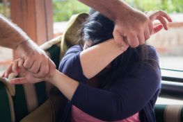 A woman being held recklessly in both hands