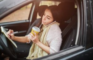 Woman driving distracted to work