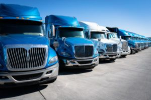 blue semi-trucks parked