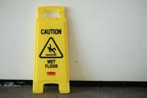 Wet floor sign warns against slip and fall accident