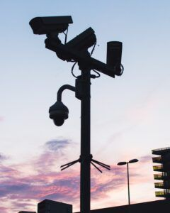 Red light cameras on pole by intersection