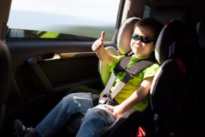 Child in car safety seat in car