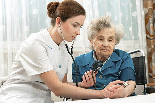 Nurse providing proper care in nursing home