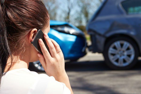 lady on cellphone after car accident
