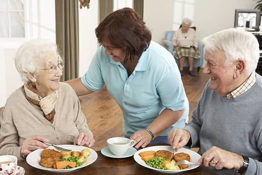 senior citizens having a meal