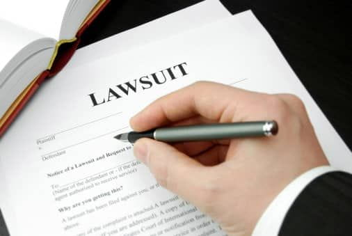 Attorney fills lawsuit paperwork out for Mass Tort Clients