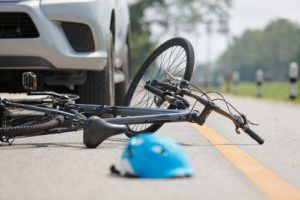 What happens if a bike hits a car door?