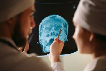 Doctor explaining result on xray of patient.
