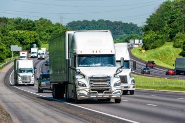 Trucks and personal vehicles navigate a busy interstate 81.