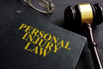 Personal injury law book and a gavel.