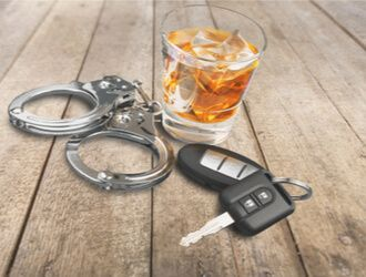 DUI - keys with alcohol and handcuffs