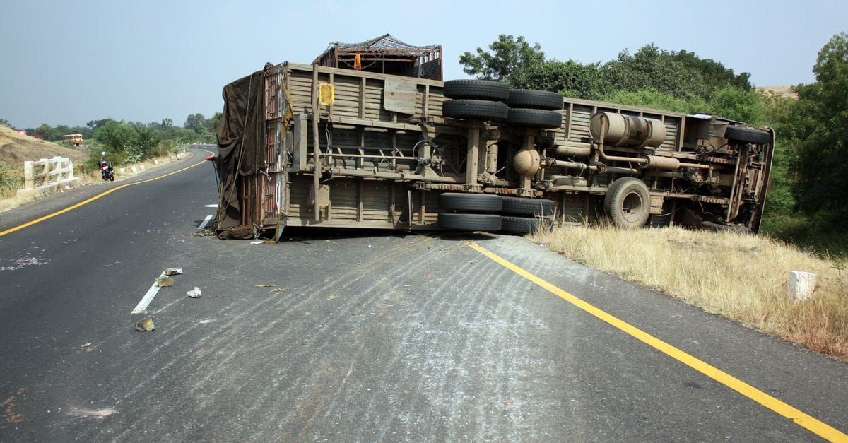 View overturned truck on highway accident