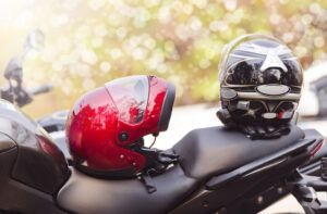 2 helmets on top of a motorcycle