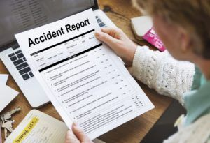 Woman reading accident report.