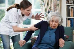 a caregiver mistreating an elder woman