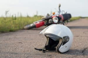 White motorcycle helmet lying on the road.