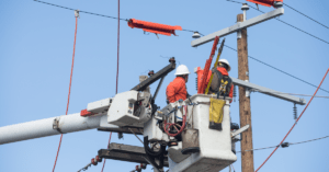 Electrical workers using bucket truck.