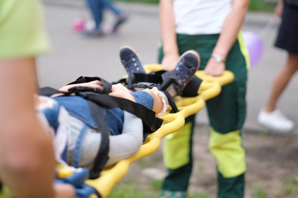 Paramedics team rescuing child injured from car accident.