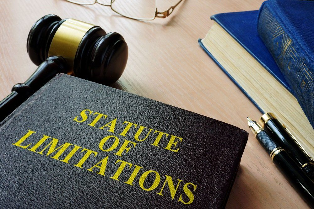 Statute of limitation book with gavel on the side.