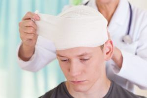 Young man with bandage experiencing trauma in accident.
