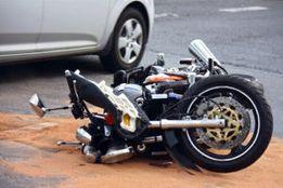 A motorcycle accident lawyer photographs a motorcycle on it's side after an accident in Rock Hill, SC.
