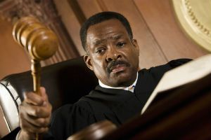 A judge holding a gavel in a South Carolina courtroom.