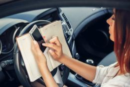 Woman using her phone while driving.