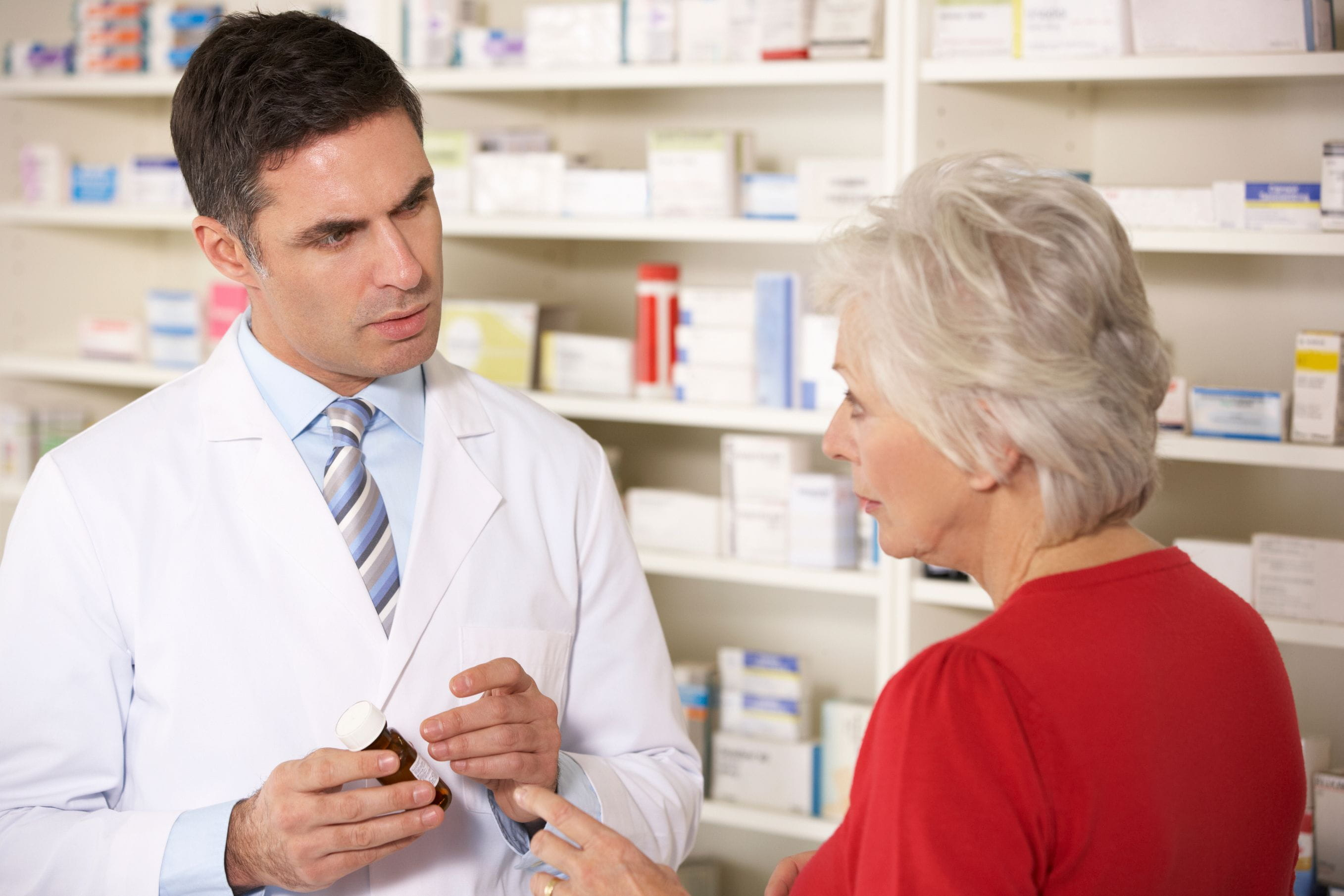 pharmacist with older woman