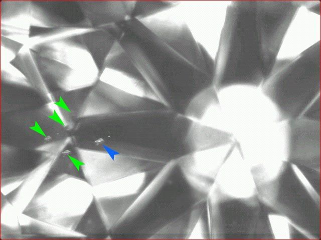 Diamond inclusions mirroring 40X.
