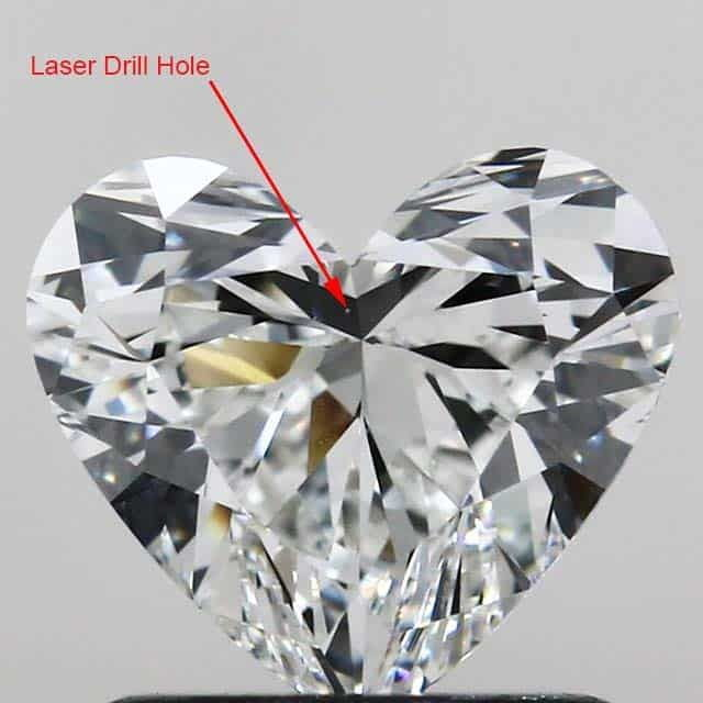 Diamond inclusion laser drill hole.