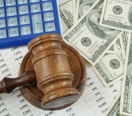 money, gavel, and spreadsheets to represent commercial bankruptcy