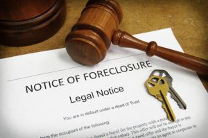 Westchester County foreclosure paperwork on a desk with a gavel and keys.