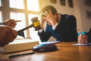 Worried man consulting his business bankruptcy attorney in White Plains NY.