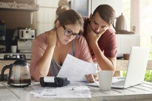 Young couple having debt problems on how to pay their loans.