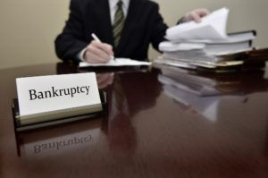 Bankruptcy lawyer sitting at desk.