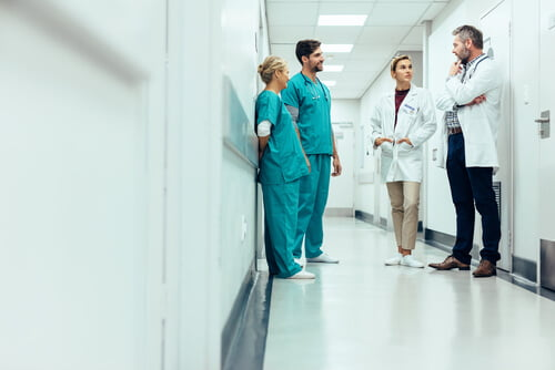 Doctors in a Washington D.C. hospital discussing a medical error caused by negligence.