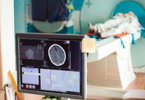Woman undergoing MRI in Washington D.C. after her doctor failed to diagnose her cancer.