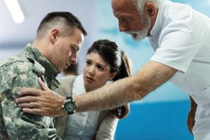 Doctor talking to army soldier who came with his wife to medical appointment at a Washington D.C. hospital.