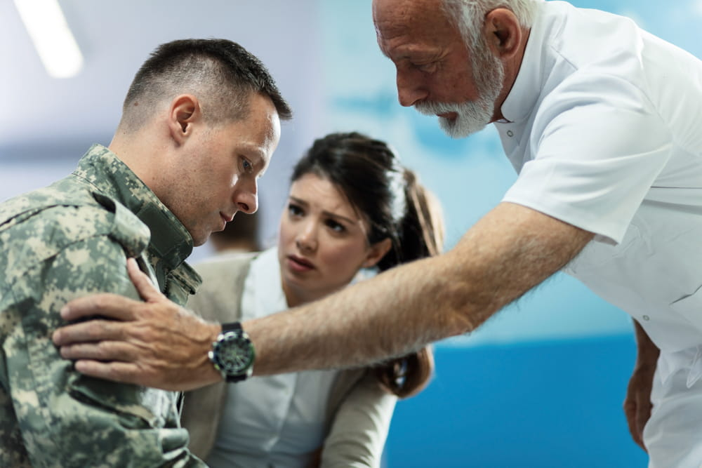 Doctor talking to army soldier seeking a military medical malpractice claim in Washington D.C.