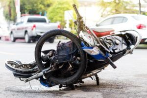 Close-up of a motorcycle, crushed by a severe accident.