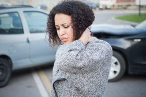 Woman suffering whiplash from an accident.