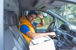 Delivery Man Checking List In Van